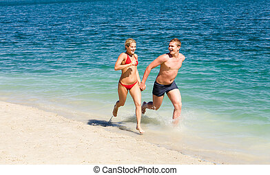Recreation - Portrait of woman and man running together...