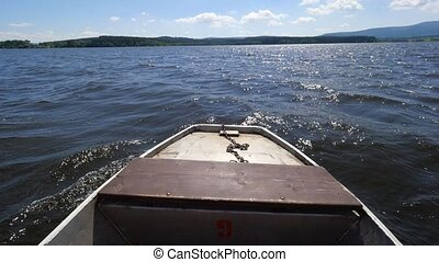 Recreation rowing on the lake in a summer day. Nose of metal...