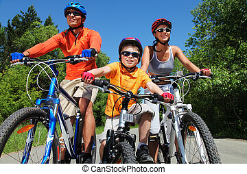 Recreation - Portrait of happy family on bicycles in the...