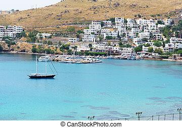 Recreation yachts near beach on Turkish resort, Bodrum, Turkey