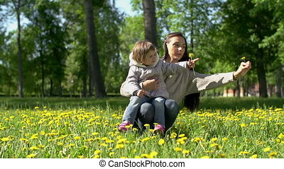 Recreational Botany - Pan of young mother playing with...