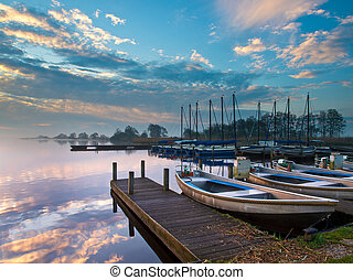 recreational harbor at a lake - Marina with rental boats in...
