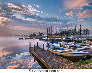 recreational harbor at a sunrise lake