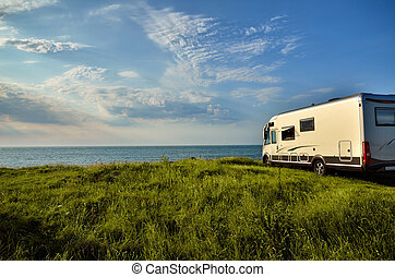 Recreational vehicle in a meadow - Recreational vehicle with...