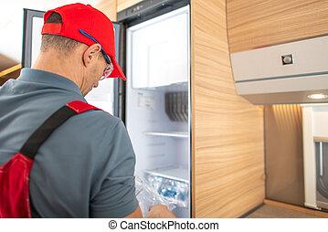 Recreational Vehicle RV Technician Replacing Travel Trailer Refrigerator