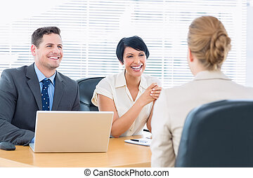 Recruiters checking the candidate during a job interview at...