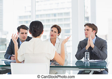 Recruiters checking the candidate during job interview - ...
