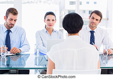 Recruiters checking the candidate during job interview -...