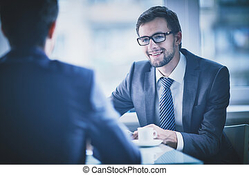 Recruiting - Image of young businessman having talk with his...