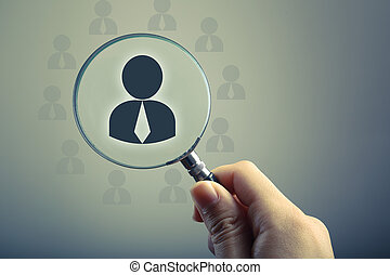 Recruitment Or Selection Concept - Hand holding a magnifying...