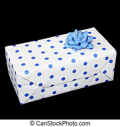 Rectangular gift wrappend in white paper with blue spots