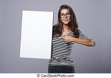 Rectangular white placard held by attractive brunette