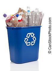 Recycle Bin - An overflowing blue recycle bin full of...