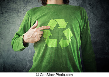RECYCLE. Man pointing to recycling symbol printed on his shirt