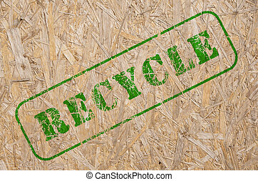 recycle stamp on a recycled wooden background