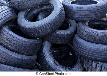 recycle tires - pile of old tires at a recycling center