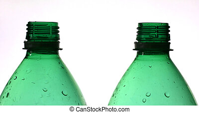Recycle - Two green plastic bottles, shallow DOF, focus on...