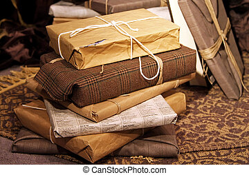 Big pile of gifts wrapped in recycled paper