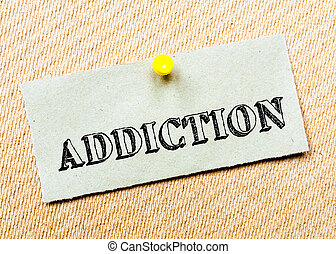 Recycled paper note pinned on cork board. Addiction Message. Concept Image