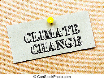 Recycled paper note pinned on cork board. Climate Change...