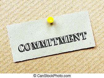 Recycled paper note pinned on cork board. Commitment Message. Concept Image