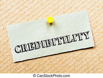 Recycled paper note pinned on cork board. Credibility Message. Concept Image
