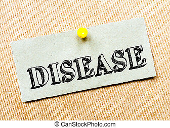 Disease Message - Recycled paper note pinned on cork board. ...