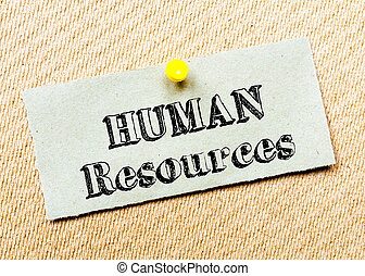 Recycled paper note pinned on cork board. Human Resources message. Concept Image