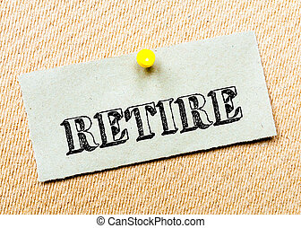 Recycled paper note pinned on cork board. Retire Message....