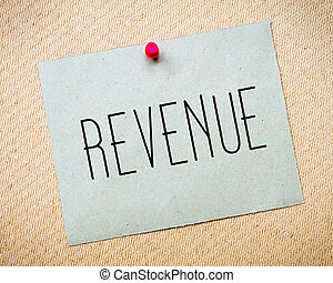 Recycled paper note pinned on cork board. Revenue Message. Concept Image