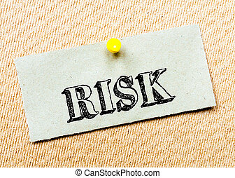 Recycled paper note pinned on cork board. Risk Message. Concept Image