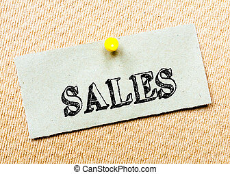 Recycled paper note pinned on cork board. Sales Message. Concept Image