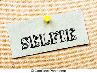 Recycled paper note pinned on cork board. Selfie Message. Concept Image