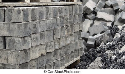 Recycled Paving Stones on Stacked and Piled Closeup Tilt -...