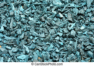 Recycled shredded tire rubber background - Blue Recycled...