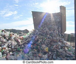 Recycling. A truck dumps PET bottles in the pile.