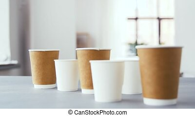 various disposable paper cups for hot drinks - recycling and...