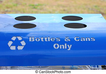 Recycling Bin - Close up of the top of a blue recycling bin