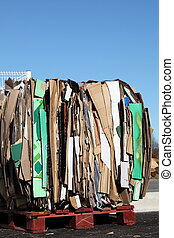 Recycling Cardboard Packaging - Segregated flattened and...