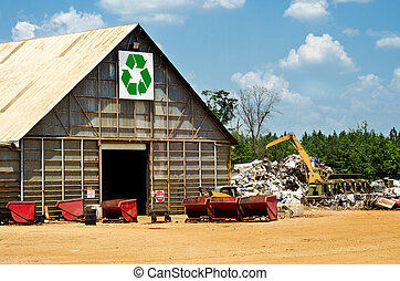 Recycling center with scrap yard and heavy machinery