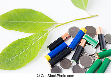 close up of green alkaline batteries - recycling, energy, ...