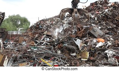 Recycling industry - Picking up metal for recycling