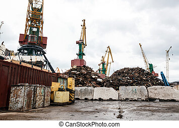Recycling, loading scrap metal in the ship on a port