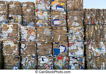 Recycling paper cubes - A big stack of paper bales for...