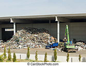 Loading garbage and waste for recycling. Protecting the environment