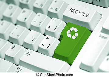 Recycling - recycle symbol on the computer keyboard in green