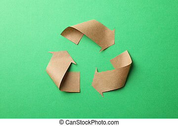 Recycling sign on green background, top view