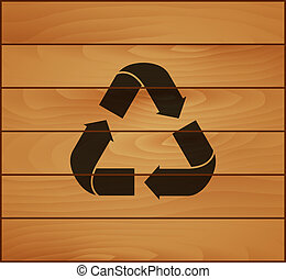 Recycling sign on top of the wooden planks texture