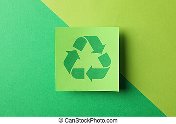 Recycling sign on two tone background, top view