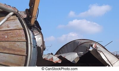 Recycling steal construction - Bulldozer destroy old silo...